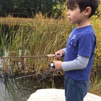 Jaren intensely watches his bobber at Freestone lake